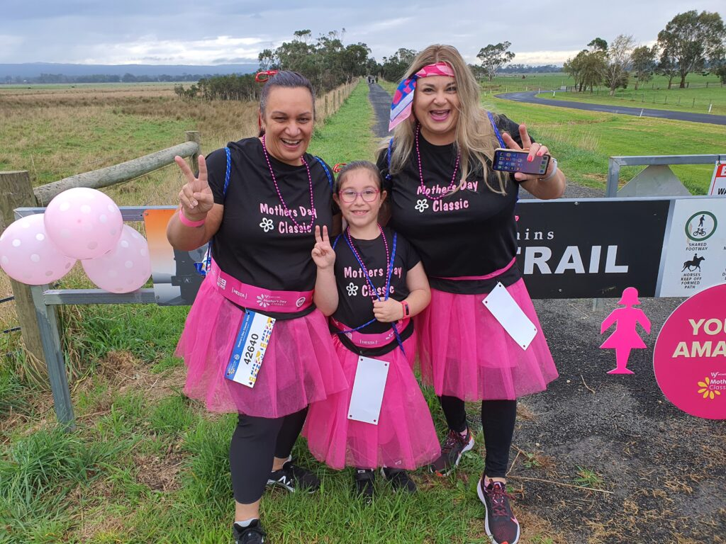 Excited locals dressed in pink get ready to participate in the Mother's Day Classic along the Gippsland Plains Rail Trail