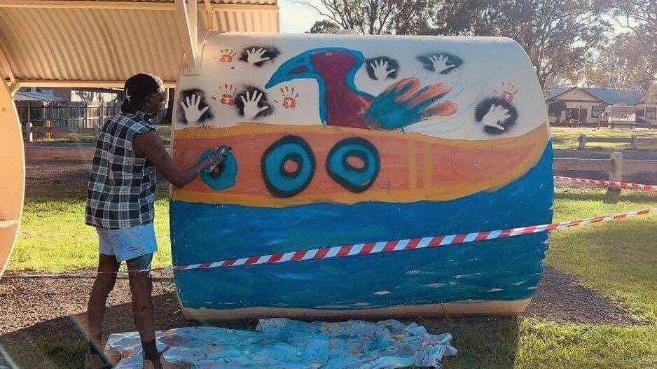 Gunnai artist Ronald Edwards Pepper creates artwork along the Gippsland Plains Rail Trail